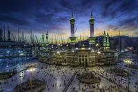 Large group of people gathering outside Al-Masjid al-Haram, Mecca, Saudi Arabia