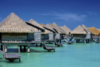 Beach cabanas in holiday resort on sunny day