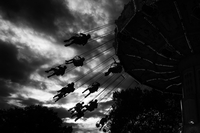Silhouette of people enjoying the carousel ride, Nuremberg, Bavaria, Germany