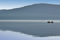 Two people in canoe on river, Deep River, Ontario, Canada