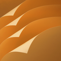 Folded corners of orange color paper pages