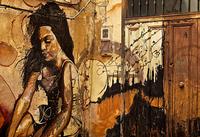 Graffiti of woman on wall, Granada, Andalusia, Spain