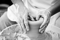 Male hands on pottery wheel, Spain