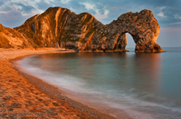 Durdle Door natural arch rock formation at sunset, Jurassic Coast, Dorset, England, UK