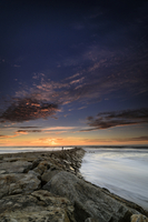 Breakwater under moody sunset sky, Cortegaca, Ovar, Centro, Portugal