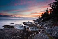 Sunset over Lighthouse Park coastline, Vancouver, Canada