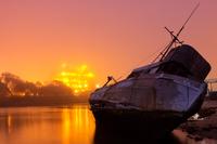 Ship wreck and sunset, Moss Landing, California, USA