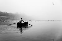 Fisherman in rowboat on lake, Kerkini, Serres, Greece