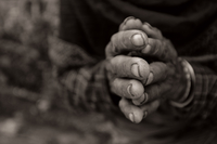 Close-up of hands in prayer, Nepal