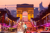 Traffic on street at dusk, Paris, France