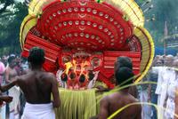 Man wearing red Theyyam, Kerala, India