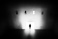 Silhouette of man walking into glowing door, Stuttgart, Baden-Wurttemberg, Germany