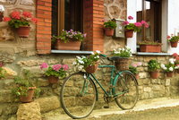 Bicycle standing at wall of country house, Agrovejo, Spain