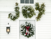 Christmas decorations on door of house