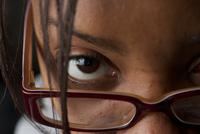 Close-up of young woman staring at camera, Albany, New York, USA