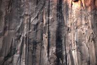 Man climbing El Capitan rock formation, Yosemite National Park, California, USA