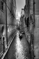 Gondola in narrow canal, Venice, Italy
