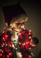 Baby boy in Santa Claus costume looking down, Valladolid, Spain
