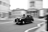 Taxi on street, London, England, UK