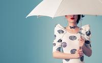 Woman holding white umbrella