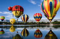 Hot air balloons above lake, Colorado, USA