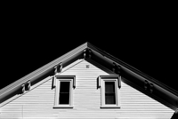 Roof and windows of house at night