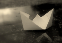 Paper boat floating on water, Poortvliet, Zeeland, Netherlands