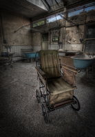 Wheelchair in old, abandoned hospital, Birmingham, West Midlands, England, UK