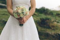 Mid section view of bride with bouquet, Rogaland, Norway