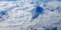 Mount Fuji surrounded by clouds, Shizuoka Prefecture, Honshu Island, Japan