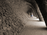 Couple walking in Park Guell, Barcelona, Spain