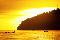 Silhouette of boats with people at sunset, Sumatra, Indonesia