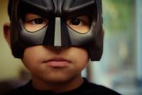 Boy (6-7) wearing superhero mask, Milptas, California, USA