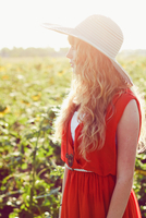 Young woman standing on field of sunflowers, Castroville, Texas, USA
