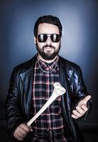 Portrait of man holding bone