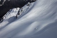 Skiing athlete on mountain slope