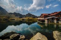 Hotel by mountain lake, Fagaras Mountains, Sibiu county, Romania