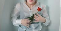 Woman lying in bathtub with red rose, Korea, Seoul