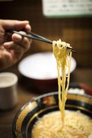 Spaghetti pasta on chopsticks, Kyoto, Japan