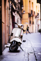 Vespa on sidewalk in street, El Carmen, Valencia, Spain