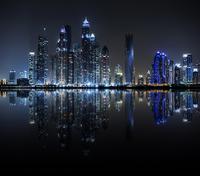 Night view of Dubai Marina reflected in water, Dubai, United Arab Emirates