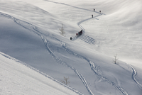 Mountain climbers walking in snow, Val Maira, Italy