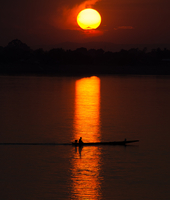 Silhouette of fishing boat on Mekong river at sunset, Vientiane, Laos