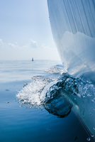 Sailboat making waves on water