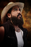 Portrait of mid adult bearded man, Puerto Angel, Oaxaca, Mexico