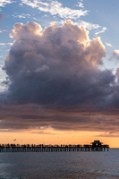 Clouds over jetty on ocean, Naples, Florida, USA