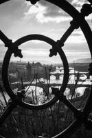 Bridges on Vltava river seen through fence, Prague, Czech Republic