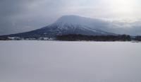Mountain across snowy field, Kutchan, Hokkaido, Japan