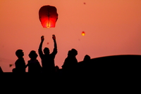 People launching chinese lanterns, Gujarat, India