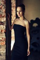 Portrait of woman in black evening dress